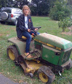 Young woman on tractor