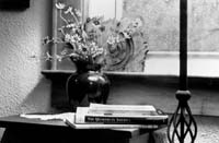 Vase, flowers, books