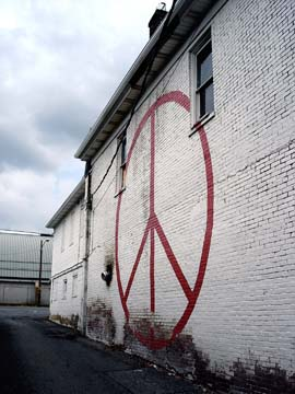 Peace symbol on side of building