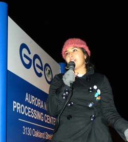 APC member Tania, speaking at immigration rally