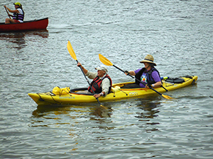 Buffy Curtis and Liseli Haines paddling with the Two Row Wampum Renewal Campaign