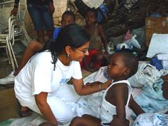 AFSC partner Handicap International's staff helping a child in Haiti
