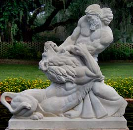 sculpture of man fighting lion